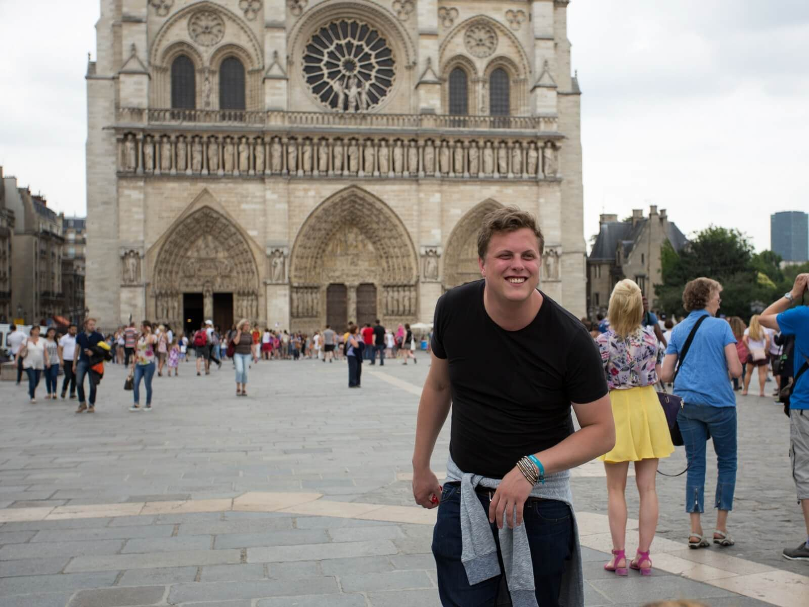 Man in front of Notre Dame Cathedral pretending to be the Hunchback