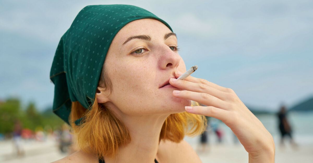 Woman smoking a cigarette without a care in the world