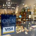 store with visa sign in the window: Store hours and credit cards in France