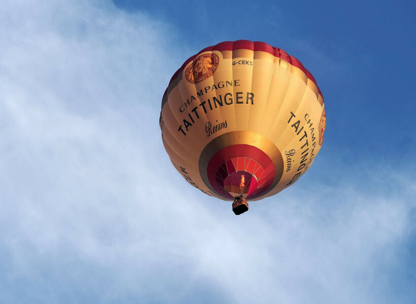 Hot air balloon in the sky with the inscription