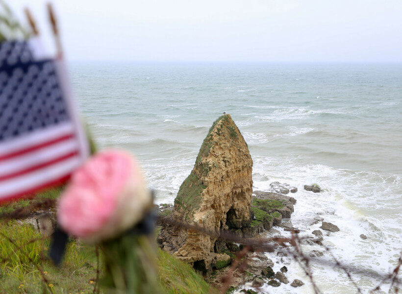 Pointe du Hoc with American flag in the foreground: D-Day History