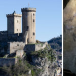 the castle in foix: medieval castle on top of a hill