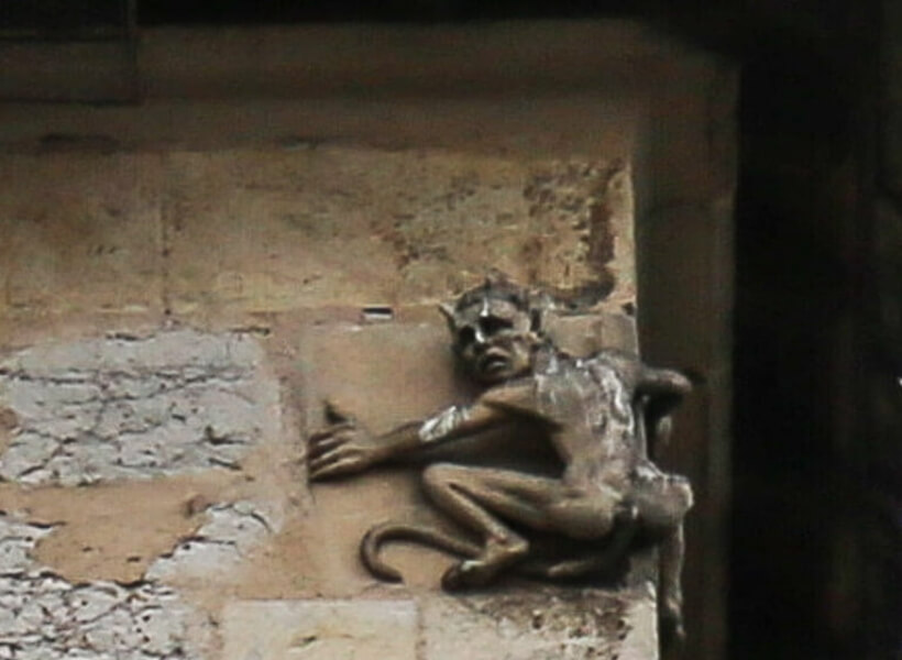 the devil carved on the valentré bridge in Cahors, France