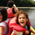 Matt's daughter having fun in a canoe with their mother at the helm: loire valley and dordogne episode