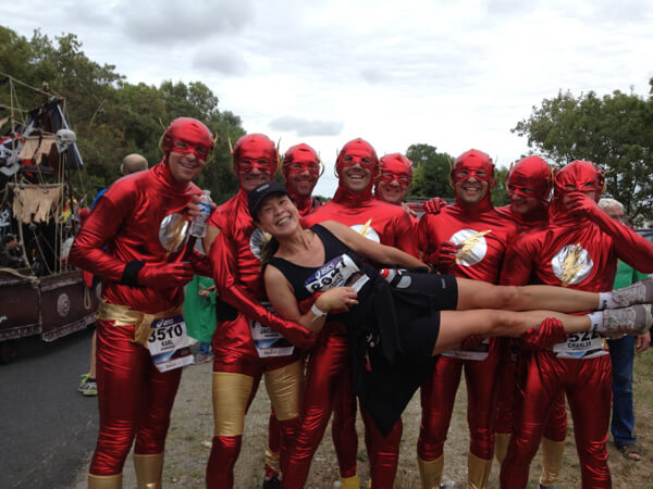 Janice at the Marathon du Médoc race, the Flash Gordon running team holds her horizontally