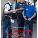 3 male police officers talking on the streets of Toulouse, France