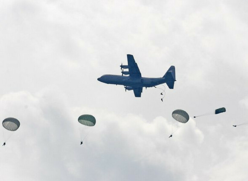 Paratroopers re-enacting the events of D-Day by jumping out over Normandy from a vintage airplane: Normandy WW2 episode