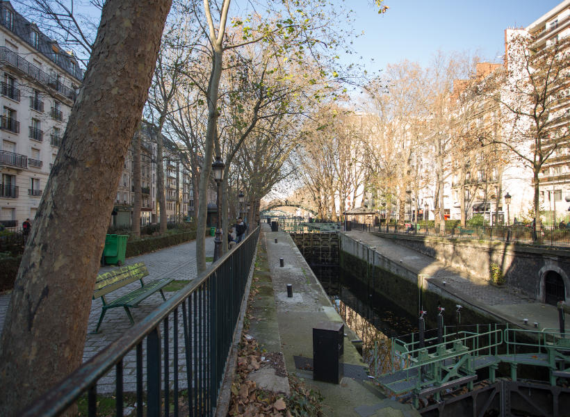 man walking along the canal saint-martin