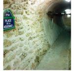 tunnel and sign at the Paris sewer. Sign reads place de la Résistance 7th arrondissement