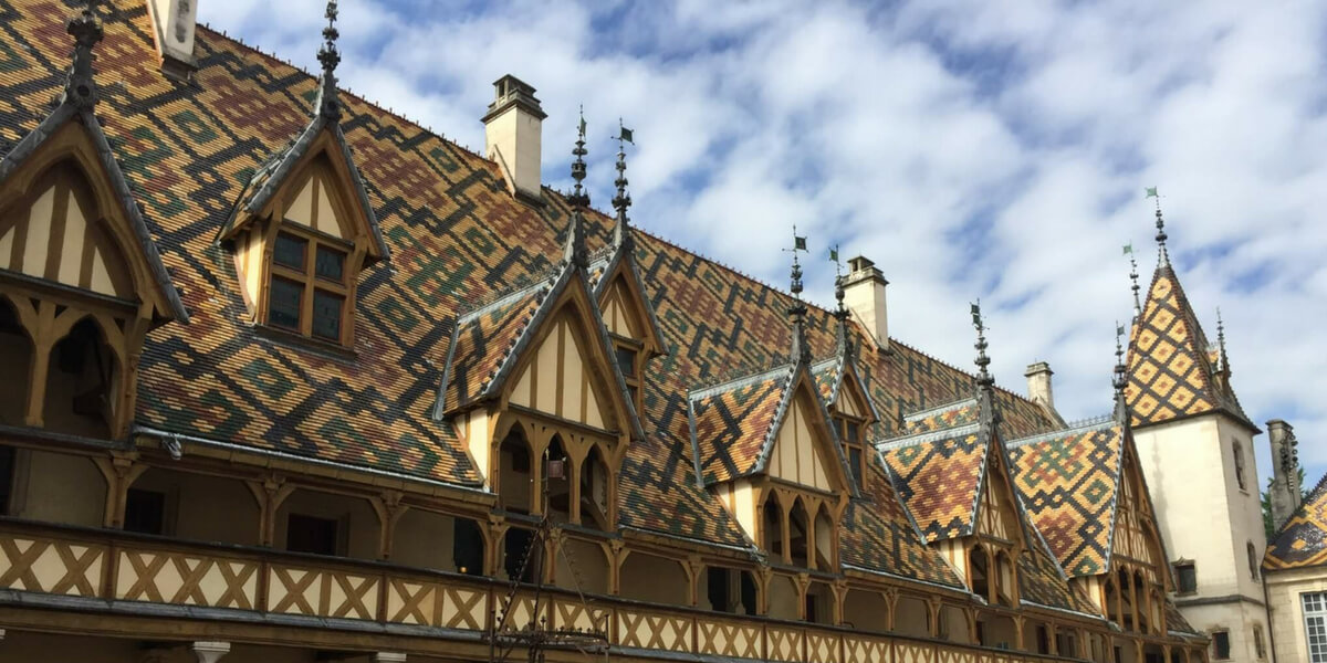 Colorful roof on the Hospice de Beaune which is typical of the area