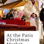 Street magician on stilts at the Paris Christmas Market