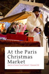 Street magician on stilts at the Paris Christmas Market