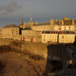 city of Saint-Malo at dusk showing the rampart walls mentioned in the book all the light we cannot see