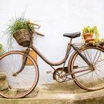 Tour the south west of france, ornamental bicycle against a wall