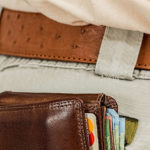 man with wallet sticking out of his back pocket