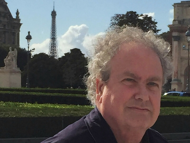 Secrets to Finding an Apartment in Paris, Phil Goldsmith with Eiffel Tower in the background