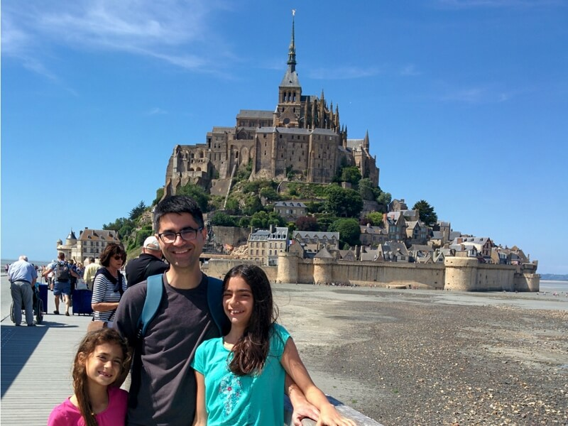 Matt and his daughters in front of the Mont-Saint-Michel; Brittany with Kids
