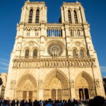Notre Dame Cathedral seen in the evening light against a blue sky background
