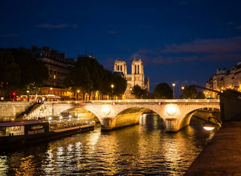 Pont Saint Michel and Notre Dame at night; 10 things to do in paris for first time visitors