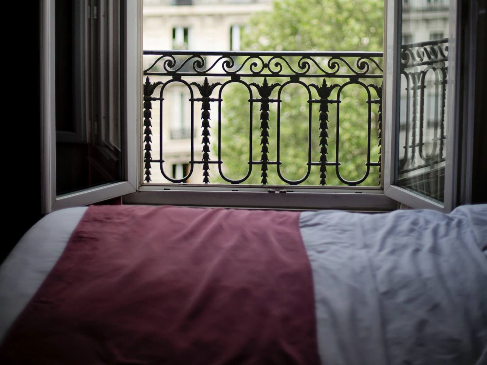 Hotel room in Paris with open window; Paris Hotels We Use and Recommend