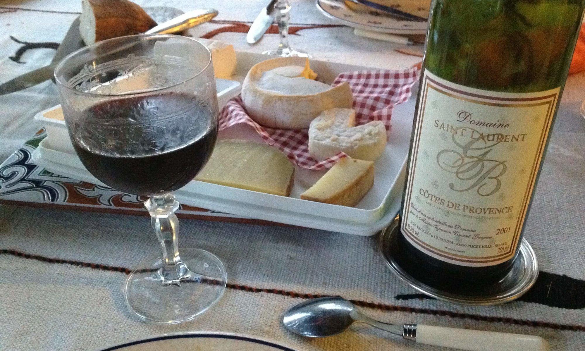 wine and cheese on a dining table; French Lifestyle and Customs