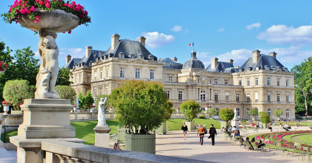 The Luxembourg Garden and French Senate under blue sky and lovly white clouds