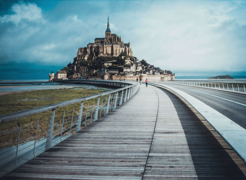boardwalk that leads to the mont saint michel