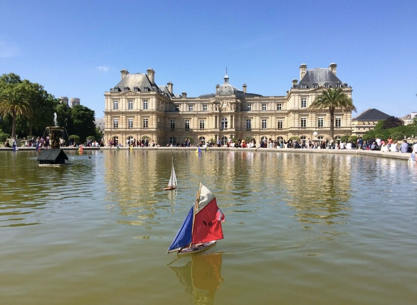 Luxembourg Gardens, pond and toy boat with the Senate building in the background