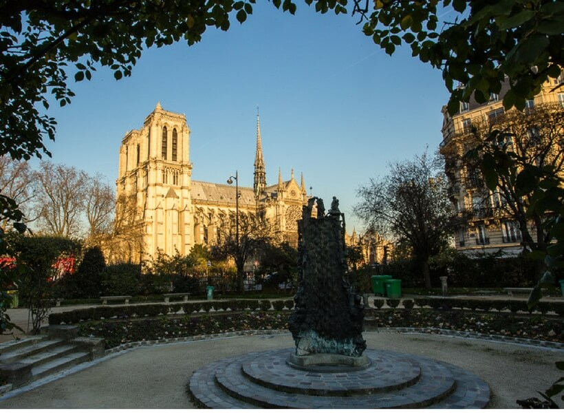 notre dame cathedral seen from a distance; how to do a layover in paris on your own