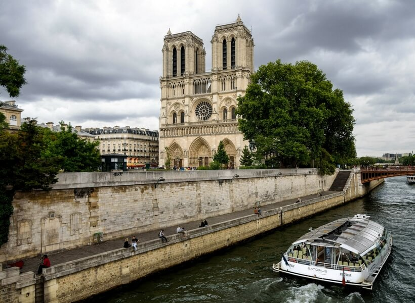 notre dame cathedral seen from the river; paris highlights