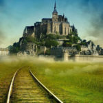 mont saint michel with imagined train tracks going all the way to the mont