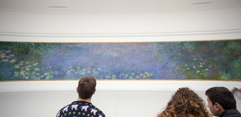 Overview of Paris Museums: people looking at the Lily-Pads at the Orangerie Museum
