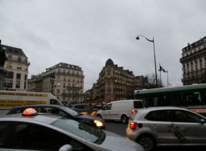 messy traffic in Paris with cars going in every direction; What Is It Like Driving in France