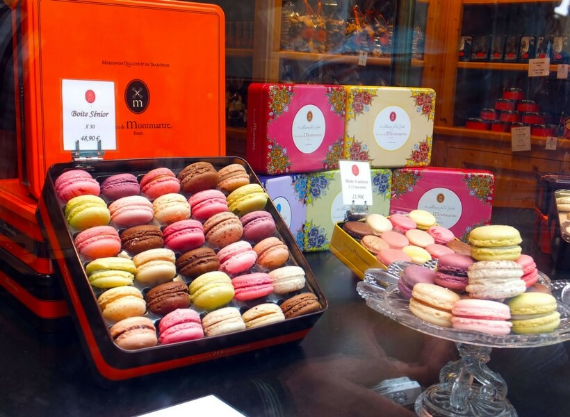 boxes of macarons in a store window