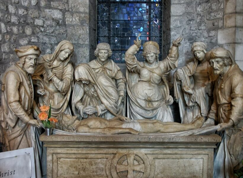 sculpture showing the burial of Jesus inside of the Reims Cathedral; day trip to Reims from Paris
