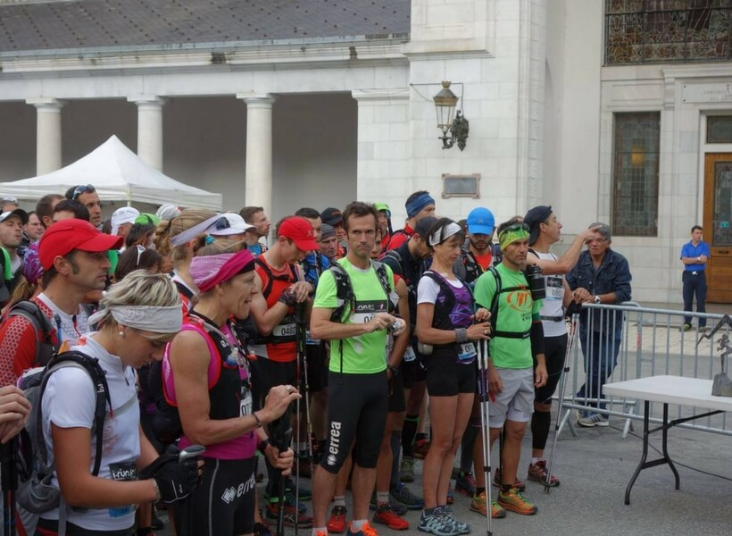 Marion Clignet waiting for the start of a race with trekking poles, group of runners