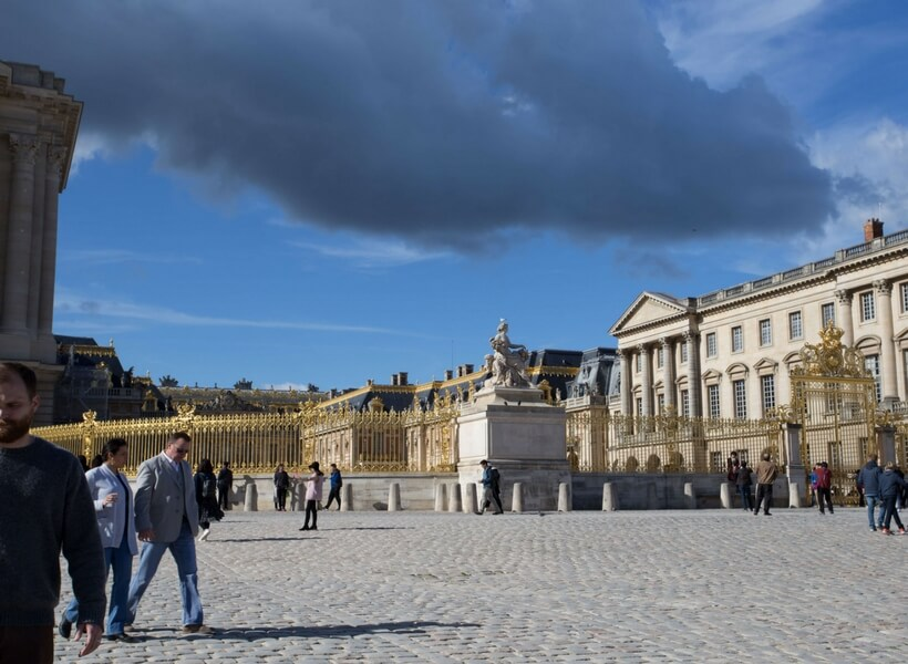 a view of the Versailles courtyard; day trip to versailles from paris