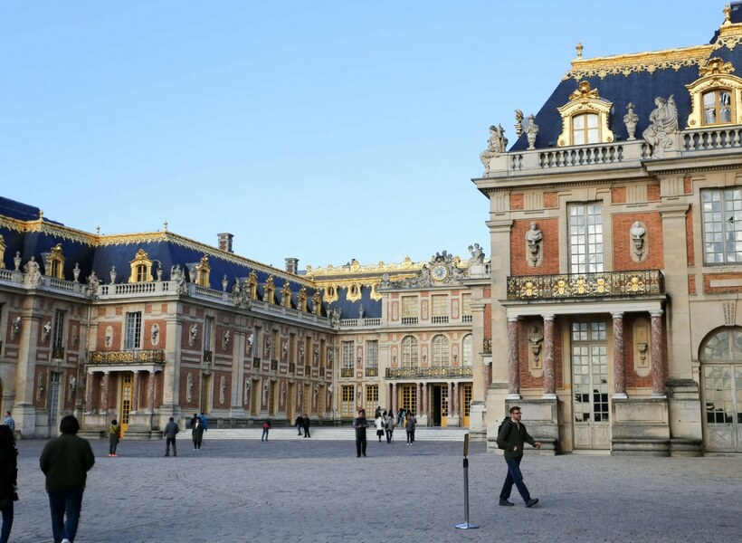 another view of the Versailles courtyard and gilded roof; day trip to versailles from paris