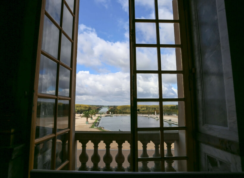 a view on the Versailles gardens from the Château, open window. Day trip to versailles from paris