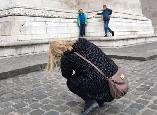 Erin taking a picture of her children in Paris