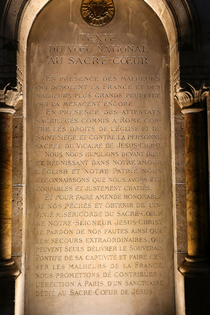 Mission statement written in stone inside of the Sacré Coeur Basilica in Paris