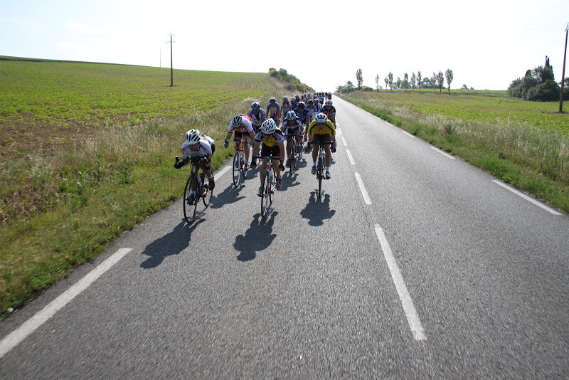 group of riders in the french countryside