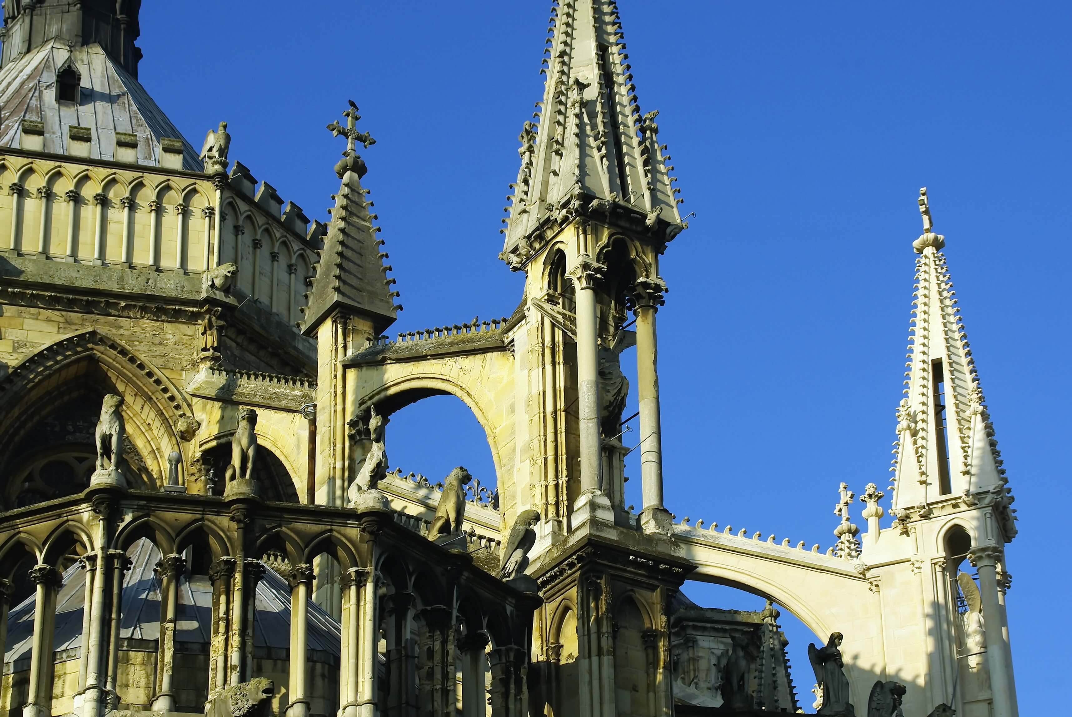 flying buttresses at the Reims Cathedral; day trip to Reims from Paris