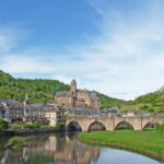 the city of Estaing in the Aveyron: river and medieval bridge