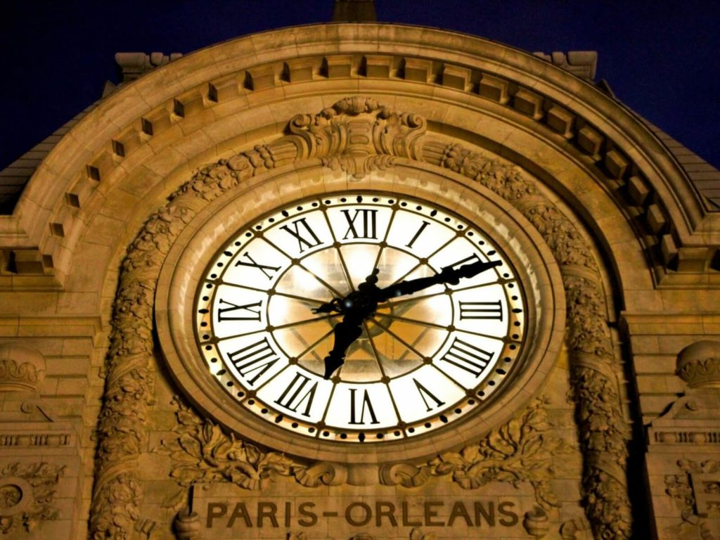 the orsay museum clock seen from the outside of the museum