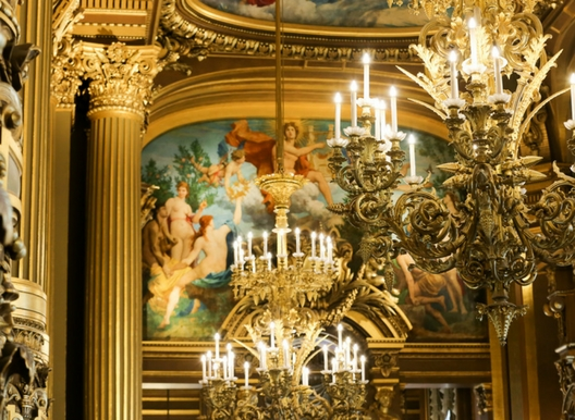 amazing chandelier at the Opera Garnier in Paris surrounded by guilded walls and art