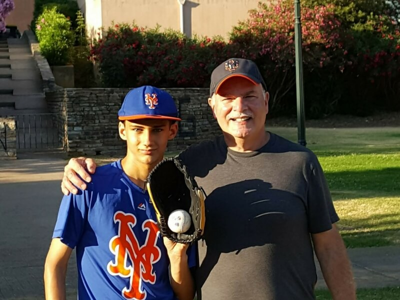 william and his young protege in corsica: the boy is wearing his baseball attire with glove and ball