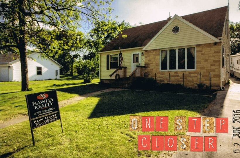"photo of claire and tony's house in the usa with for sale sign on the lawn and a caption that says ""one step closer"""