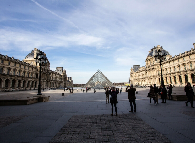 the courtyard of the louvre with the pyramid in the center