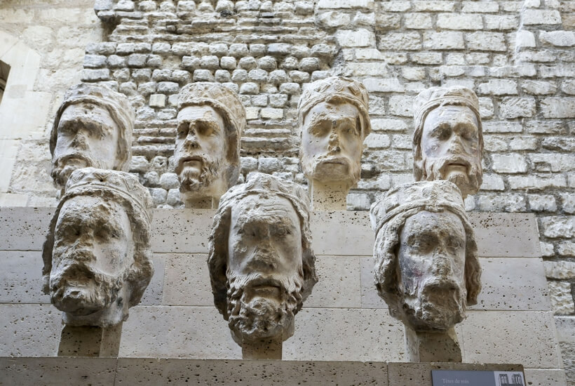 the heads that used to adorn Notre Dame Cathedral and were knocked off during the French Revolution. walking tour at the cluny museum in paris episode